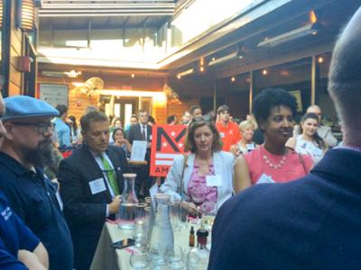 Photo of the networking party on the rooftop of Jack Rose Dining Saloon